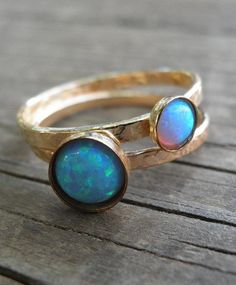 AnnalisJewelry's stacking set of opal rings pairs two of our favorite trends in a single glittering package. #etsyjewelry