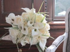 Ivory and calla lily handtied with china grass and pearls