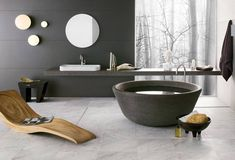 Modern Black Bathroom Design with Lounge Chair and Scenic View – Contemporary Bathrooms from Neutra.