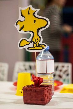 Snoopy birthday party centerpiece! See more party planning ideas at CatchMyParty.com!