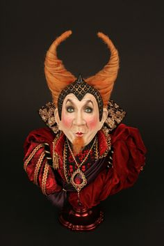 "Leslie Jordan as ""The Little Devil"", by Dustin Poche'  This piece was designed as Leslie Jordan going to a Hollywood masquerade ball.  I envisioned him having a Devilishly good time!  16 INCHES (40.64) Tall  Paper clay, wool, acrylic paint, embossed satin, silk, velvet."