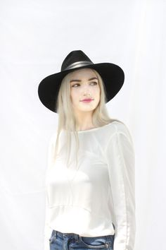Keep cool with these summer essentials! A wide brimmed hat and a light backless top to stay breezy.