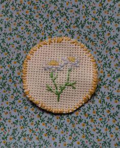 chamomile cross stitch pin badge