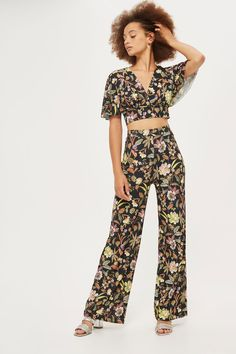 **Floral Wide Leg Trousers by Love