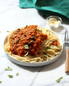 This Lentil Bolognese Sauce is hearty with Red lentils and Mushrooms. 22 Gm of Protein Served over spaghetti. Vegan Soyfree Nutfree Recipe Can be glutenfree with gluten-free pasta Lentil Recipes, Vegan Recipes Easy, Pasta Recipes, Vegetarian Recipes, Vegetarian Options, Vegan Dinners, Lentil Bolognese, Bolognese Sauce, Large Family Meals