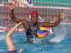 Goalie Ashleigh Johnson of the U.S. women's water polo team, defends the net. A talented player.