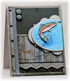 handmade card for a fisherman ... leaping rainbow trout .. stamped wood grain panel ... grays and aqua with touches of brown ... great card!
