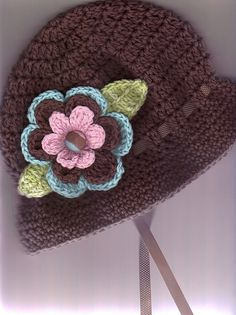 hat with flower and ribbon. ravelry