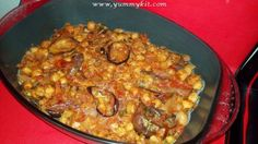Arabic Veg dish - Aubergine Chickpea Bake -Traditional Middle eastern -Moroccan veg bake , Aubergines/ Egg plants and chick peas baked with tomatoes, onion, spices and herbs.