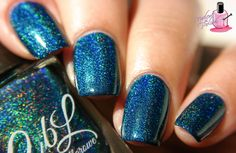 Colors by Llarowe Winter 2015 - Peacock Parade is a deep blue toned teal holographic. Swatch by @nailedthepolish on Instagram.