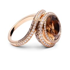 18ct rose gold ring with a round smokey quartz and chocolate and white diamonds