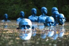 Sculptures of Blue Men Submerged in Water Leave Visual Commentary on Climate Change - My Modern Met