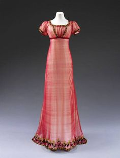 via Mimi Matthews ~ Evening gown, circa 1810. It is made of silk net, embroidered with chenille thread, and trimmed with silk ribbon. (Image via Victoria & Albert Museum)