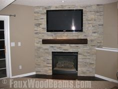 You are wondering how is it possible to change a fireplace around. It is understandable as a fireplace is constructed from brick and mortar and is concreted as a permanent part of your house. Faux Wood Beams, Fake Fireplace, Fireplace Makeover, Faux Stone Fireplaces, Fake Fireplace Mantel, Cabin Fireplace, Fireplace Tv Wall, Fireplace, Basement Design