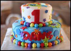 1st-birthday-cakes 2 tier-for-boys lion, monkey