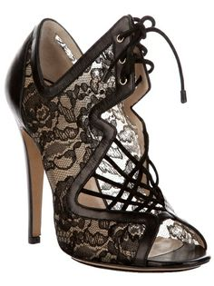 Black leather sandals from Nicholas Kirkwood featuring an open toe, a lace-up front fastening and a black leather stiletto heel.