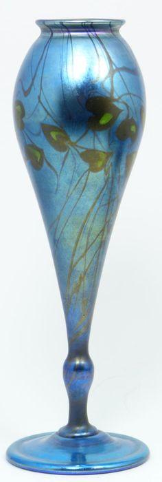 Louis Comfort Tiffany blue & green art glass vase having green leaf form designs over blue iridescent ground.