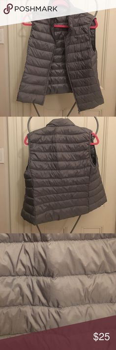UNIQLO grey feather light vest great for travel Never worn UNIQLO grey vest bought in China. Size L but runs small. Comes with travel bag. Can be folded into the size of a fist. Weighs nothing. Stuffed with feathers. Machine washable. Uniqlo Jackets & Coats Vests