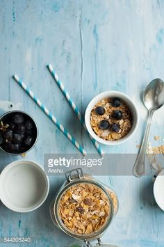 Stock Photo : Muesli breakfast with oats on a blue wooden background