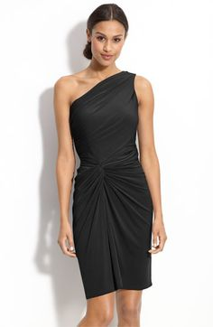 Maggy London Side Twist One Shoulder Jersey Dress: An off-center twist at the waistline shapes a fitted jersey dress fashioned with a high, alluring side slit.