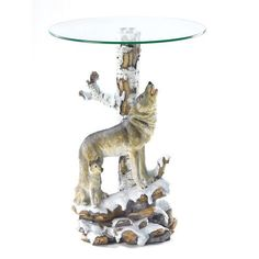 Decorative howling wolf accent table with a round glass top. This unique wolf accent table will compliment the decor of any collector's home.