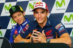Valentino Rossi looking over Marc Marquez' shoulder.