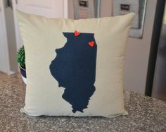 Show your pride for the great state of Missouri!! We can make this pillow in ANY of the 50 states. This purchase is for the Missouri 18 x 18 cover only. The 18x18 zippered pillow cover is a beige cotton natural faux linen with a black felt Missouri. The felt state also comes in Navy or charcoal gray. A red wooden heart button is sewn on the location of your choice. Need more hearts? We can add as many as you like. ****** At checkout please list the city where you would like your wooden red…