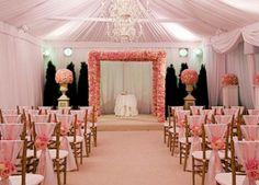 A posh pink rose wedding ceremony decor featured on wedsavvy.com