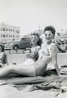 Two lovely vintage gals soaking up the rays in matching sunnies ~