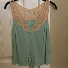 Urban Outfitters Light Blue/Mint Green Lace Top Pretty and delicate button-down cotton top with a tan/beige lace collar and tie at the bottom - PERFECT CONDITION - ONLY WORN ONCE - Urban Outfitters - The color is a mix between light blue and mint green - Kimchi Blue Tops Blouses