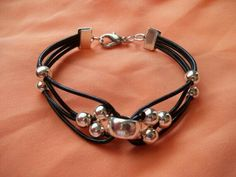 Greek Leather and Silver Bead Bracelet leather by JulesObsession Simple but intricate Leather Jewelry, Wire Jewelry, Jewelry Crafts, Beaded Jewelry, Jewelry Bracelets, Jewelery, Yoga Jewelry, Leather Bracelets, Bracelet Making