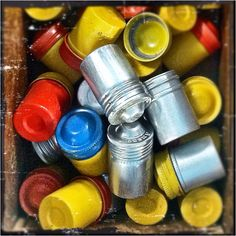 Kodak film canisters! I have a mini collection of these I put in a mason jar!
