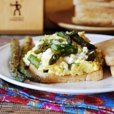Breakfast sandwich with scrambled eggs, asparagus, and melted goat cheese