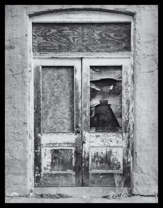 """Doors, Emporia, Kansas"" Limited Edition photograph by dwjohnson.  Print size is 8x10. Framed size is 14x16. Only 100 will be made. White mount and mat with black frame with signed and numbered certificate. #01000-01618 $ 290.00"