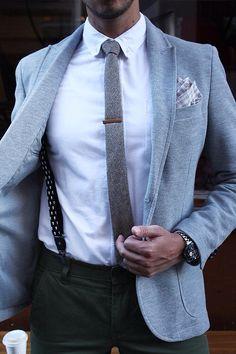 mens street style fashion: dark trouser pants, charcoal grey tie, tie clip, light grey blazer suit jacket, crisp white shirt, black suspenders, grey white checkered pocket square, designer watch (mw)