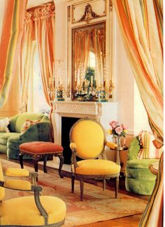 An iconic Michael Taylor living room in San Francisco. 18th century Aubusson rug came from Peru, Louis XVI chairs from Michael Taylor. The curved sofa designed by Syrie Maugham upholstered in a Brunschwig velvet. The stripe silk taffeta curtains are a Scalamandre stripe Simbolo.