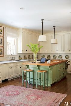 The cabinetry in designer Timothy Corrigan's Los Angeles kitchen is awash in Farrow & Ball paint in shades of white and green; a set of antique Mexican Talavera plates is arrayed against the backsplash. Green Kitchen Cabinets, Painting Kitchen Cabinets, Kitchen Cabinetry, Kitchen Paint, Kitchen Redo, New Kitchen, Kitchen Remodel, Kitchen Ideas, Kitchen Faucets