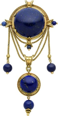 "Victorian Lapis Lazuli, Gold Brooch, French The brooch features a lapis lazuli cabochon, suspending a pendant enhanced by a lapis lazuli cabochon, stationed by fancy link 18k yellow gold chain, accented by carved lapis lazuli beads, set in 18k yellow gold, completed by a pinstem and ""c"" catch on the reverse. French hallmarks. Gross weight 32.80 grams."
