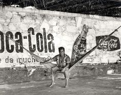 Man on Hammock in Front of Coca-Cola Wall Oaxaca Mexico Photographer Bill Perlmutter Army Photography, School Photography, Street Photography, French Street, Whitney Museum, Museum Collection, American Art, Art Museum, Coca Cola