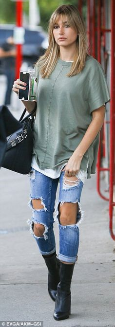 Casual:The model donned a loose, khaki-green T-shirt, worn over a plain white tee...