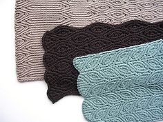 Very warm, ribbed scarf in three variations: one easy and playful with wavy edges, another no-nonsense and manly with straight edges and straight ribbed borders, and the last one complicated and stunning with slanting almond shapes.