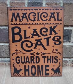 Magical Black Cats Guard This Home Handpainted wood Sign. $24.99, via Etsy.