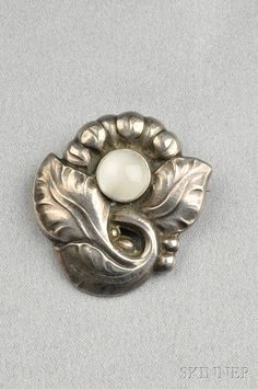 Georg Jensen Sterling Silver and Moonstone Brooch, , set with a cabochon moonstone, lg. 1 1/4 in., no. 71, signed Georg Jensen Denmark.