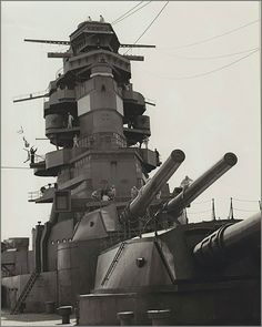 Vintage photographs of battleships, battlecruisers and cruisers.