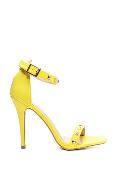 A diva-approved strappy heel, featuring dainty polished pyramid studs at toe and ankle strap, open toe, and stiletto heel. Cushioned insole. Leatherette body. Single sole. $24.90