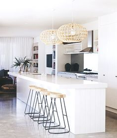 The Best Bright White Spaces// rattan light fixture, modern barstools, tropical kitchen, white kitchen