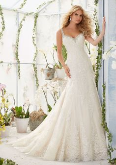 Wedding Dresses and Bridal Gowns by Morilee designed by Madeline Gardner. Crystal Beading, Alencon Lace Appliques and Scalloped Hemline on Net Wedding Dress