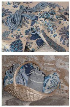 """Mariage thème """"bleu"""": sacs repas (couture) pour le dîner des enfants (pique-nique), fabriqués dans des chutes de tissus différents à motifs bleus et disposés dan un panier. À tous les étages, conseil décoration, Paris ouest, France. Laundry Basket, Decoration, Wicker, Couture, Blue Patterns, Fabrics, Decor, Decorations, Decorating"""