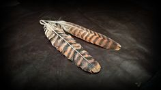 The feather in the back is the original Red Kite feather, in front is the copy in leather #raptorfeathers #b2zone #b2zoneshoplet #leatherfeathers #leatherart