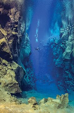 Scuba dive in between two continents at the Silfra fissure. http://exploretraveler.com WOW